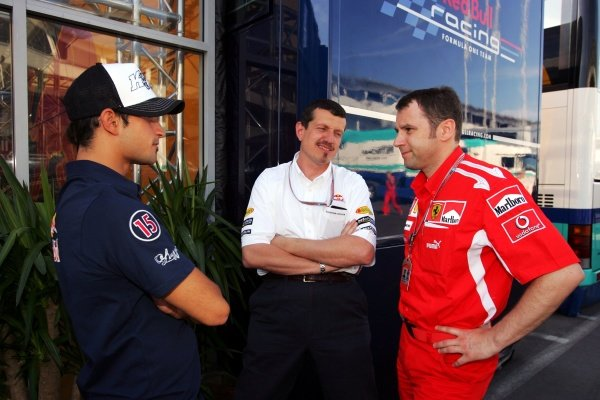 (L to R): Vitantonio Liuzzi (ITA) Red Bull Racing talks with Guenther Steiner (ITA) Red Bull Racing Technical Director and Stefano Domenicali (ITA) Ferrari Manager of F1 Operations. Formula One World Championship, Rd 7, European Grand Prix, Practice, Nurburgring, Germany,  27 May 2005. DIGITAL IMAGE