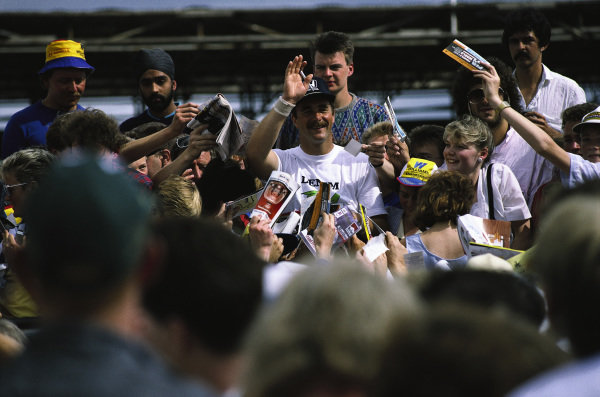 Nigel Mansell surrounded by fans.