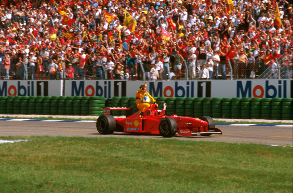 Hockenheim, Germany.25-27 July 1997.Michael Schumacher (Ferrari F310B) 2nd position, gives Giancarlo Fisichella a lift back to the pits aboard his car.Ref-97 GER 04.World Copyright - LAT Photographic