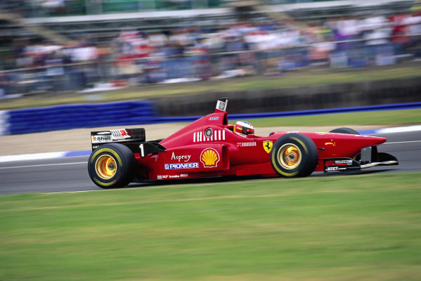 Michael Schumacher, Ferrari F310, with glowing brake discs.