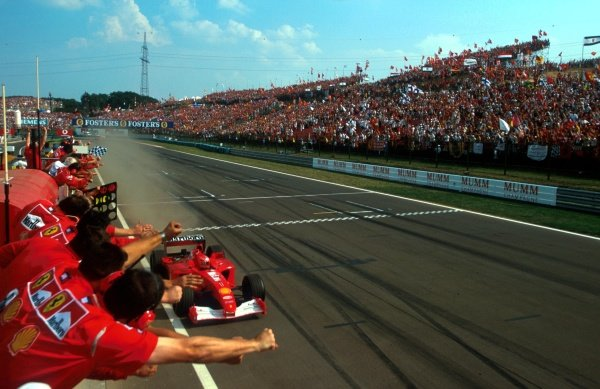 Michael Schumacher (GER) Ferrari F1 2001 crosses the finish line to win his fifty-first Grand Prix and his fourth World Championship Ð the second in a row for Ferrari. Hungarian Grand Prix, Hungaroring, Budapest, 19 August 2001.  BEST IMAGE