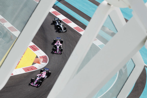 Esteban Ocon, Racing Point Force India VJM11, leads Sergio Perez, Racing Point Force India VJM11, and Valtteri Bottas, Mercedes AMG F1 W09 EQ Power+