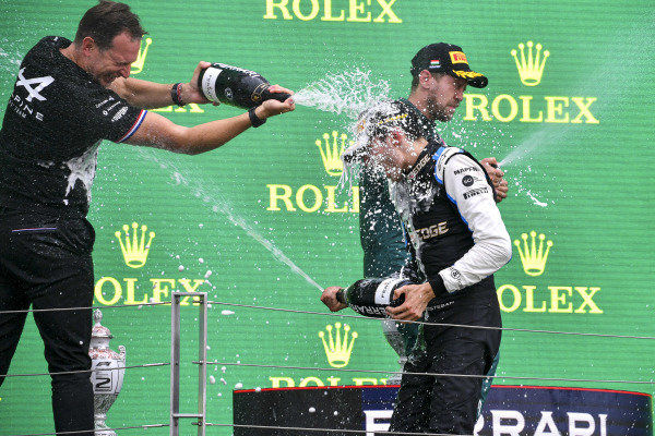 Laurent Rossi, CEO, Alpine F1, and Esteban Ocon, Alpine F1, 1st position, spray Champagne on the podium