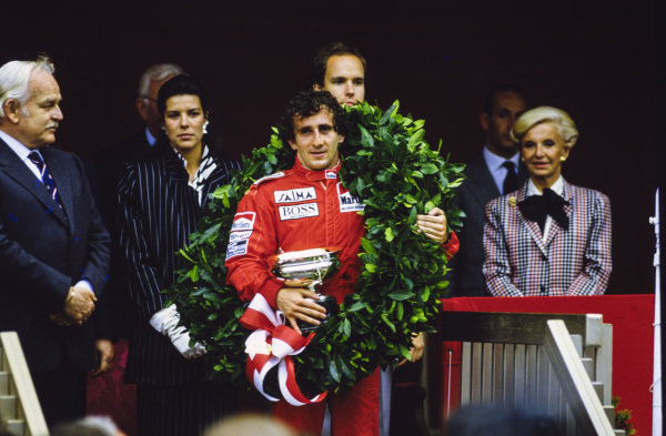 Alain Prost, 1st position, on the podium with his trophy.