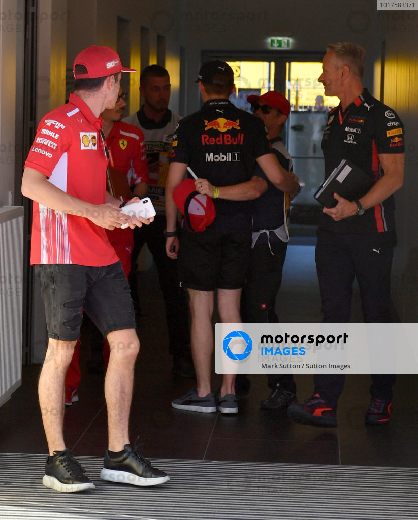 Charles Leclerc, Ferrari leaves the stewards office while looking at Max Verstappen, Red Bull Racing while Jonathan Wheatley, Team Manager, Red Bull Racing looks on