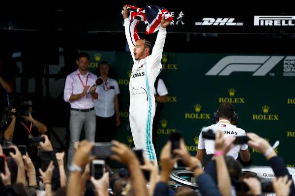 Race winner Lewis Hamilton, Mercedes AMG F1 celebrates in Parc Ferme with a flag