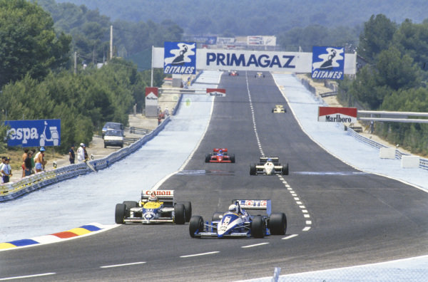 René Arnoux, Ligier JS27 Renault, leads Nelson Piquet, Williams FW11 Honda, Philippe Streiff, Tyrrell 015 Renault, and Patrick Tambay, Lola THL-2 Ford.