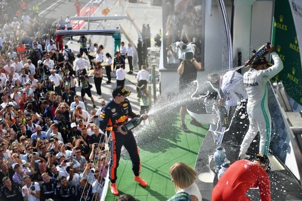 Max Verstappen, Red Bull Racing, 2nd position, sprays Champagne at Lewis Hamilton, Mercedes AMG F1, 1st position, and Sebastian Vettel, Ferrari, 3rd position, on the podium
