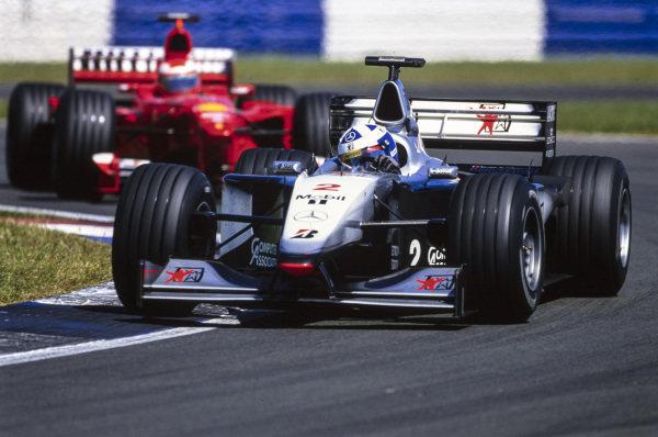 David Coulthard, McLaren MP4-14 Mercedes, leads Eddie Irvine, Ferrari F399.