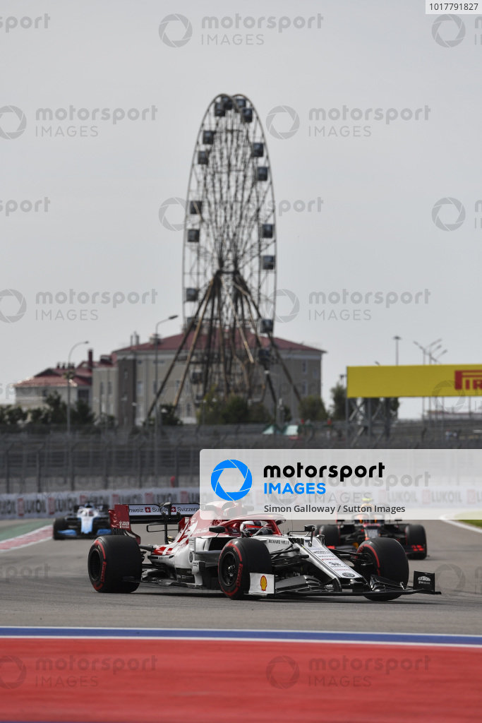 Kimi Raikkonen, Alfa Romeo Racing C38, leads Alexander Albon, Red Bull RB15