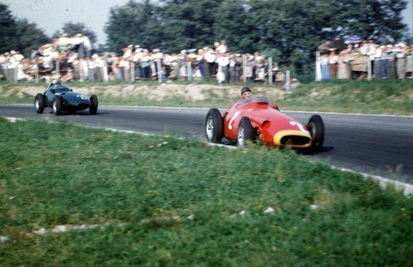 1957 Italian Grand Prix.Monza, Italy.6-8 September 1957.Juan Manuel Fangio (Maserati 250F) leads Stuart Lewis-Evans (Vanwall VW7). Fangio finished in 2nd position.Ref-57 ITA 29.World Copyright - LAT Photographic