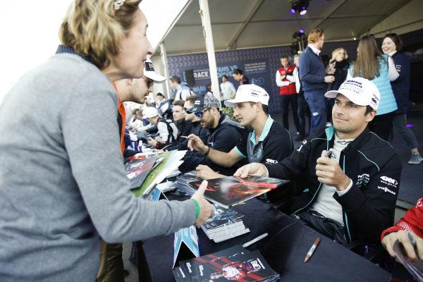 Nelson Piquet Jr. (BRA), Panasonic Jaguar Racing, and Mitch Evans (NZL), Panasonic Jaguar Racing, sign autographs