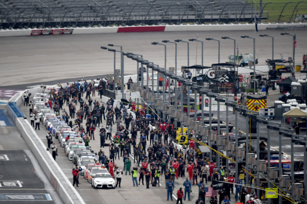 Teams stand for the national anthem on pit road,  Copyright: Jared C. Tilton/Getty Images.