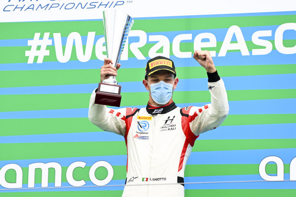 Race winner Luca Ghiotto (ITA, HITECH GRAND PRIX) celebrates on the podium with the trophy