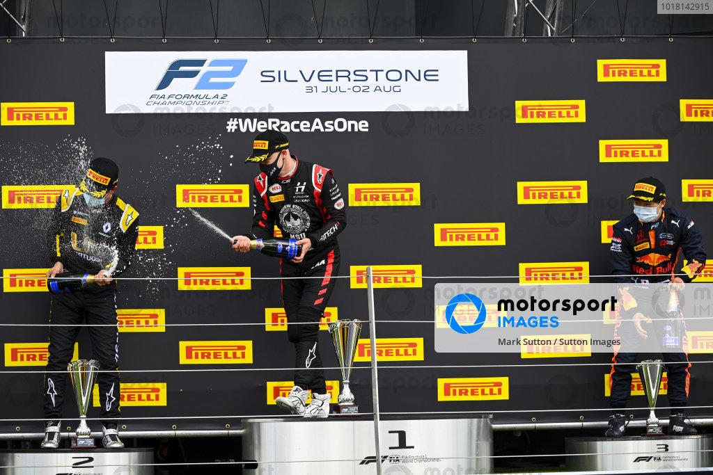 Guanyu Zhou (CHN, UNI-VIRTUOSI), 2nd position, Nikita Mazepin (RUS, HITECH GRAND PRIX), 1st position, and Yuki Tsunoda (JPN, CARLIN), 3rd position, celebrate with Champagne on the podium