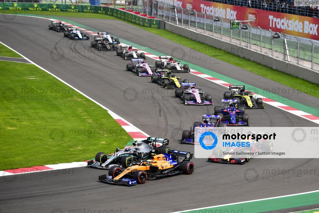 Lando Norris, McLaren MCL34, leads Valtteri Bottas, Mercedes AMG W10, Max Verstappen, Red Bull Racing RB15, Daniil Kvyat, Toro Rosso STR14, Pierre Gasly, Toro Rosso STR14, Daniel Ricciardo, Renault R.S.19, and the remainder of the field at the start