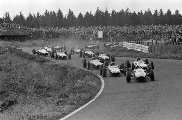 Lorenzo Bandini, Ferrari 156 Aero, leads Jim Clark, Lotus 33 Climax, Dan Gurney, Brabham BT7 Climax, John Surtees, Ferrari 158, and Graham Hill, BRM P261.