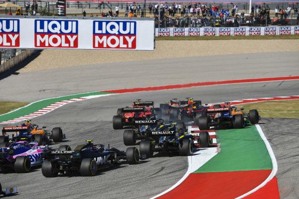 Valtteri Bottas, Mercedes AMG W10, leads Max Verstappen, Red Bull Racing RB15, Sebastian Vettel, Ferrari SF90, Lewis Hamilton, Mercedes AMG F1 W10, and Charles Leclerc, Ferrari SF90, as Alexander Albon, Red Bull RB15, and Carlos Sainz Jr., McLaren MCL34, make contact at the start