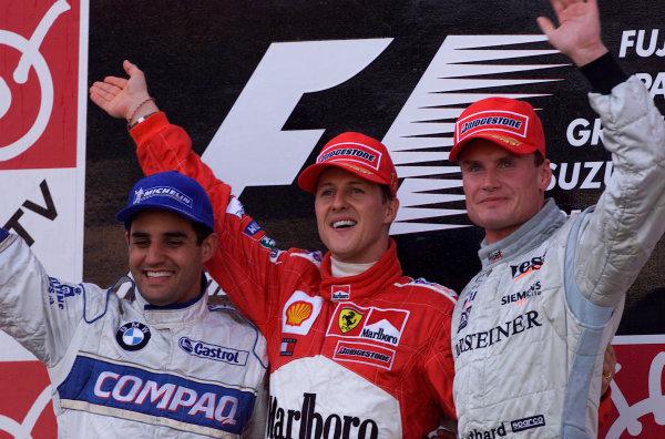 2001 Japanese Grand Prix - Sunday / RaceSuzuka, Japan. 14th October 2001Race podium, Michael Schumacher, Ferrari F2001, 1st, Juan Pablo Montoya, BMW Williams FW23, 2nd and David Coulthard, West McLaren Mercedes MP4/16, 3rd.World Copyright: Steve Etherington/LAT Photographicref: 17 5 MB Digital