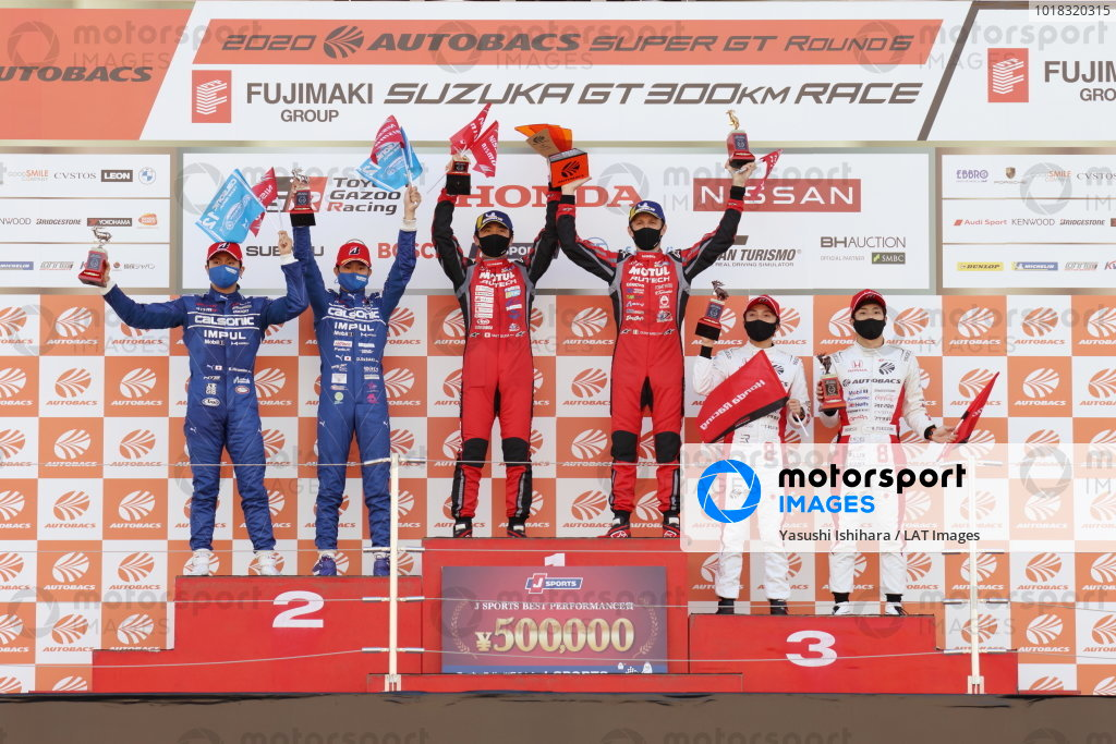 The GT500 podium. Winners Tsugio Matsuda & Ronnie Quintarelli ( #23 MOTUL AUTECH NISMO Nissan GT-R ) celebrate between Daiki Sasaki & Kazuki Hiramine ( #12 CALSONIC IMPUL Nissan GT-R ), 2nd, and Tomoki Nojiri & Nirei Fukuzumi ( #8 ARTA HONDA NSX-GT ), 3rd.