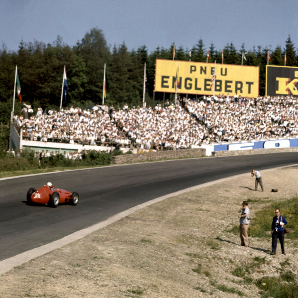 1958 Belgian Grand Prix.Spa-Francorchamps, Belgium.13-15 June 1958.Maurice Trintignant (Maserati 250F) 7th position, at Eau Rouge. Photographers stand precariously on the inside of the corner.Ref-56.World Copyright - LAT Photographic