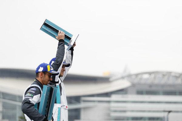 PRO AM class winner Yaqi Zhang (CHI), Team China celebrates victory on the podium