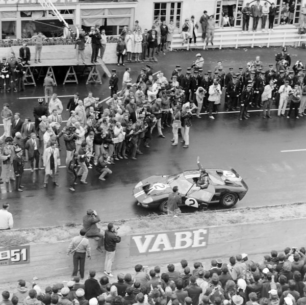 Chris Amon waves to the crowd from his Shelby American Inc., Ford Mk II at the end of the race.