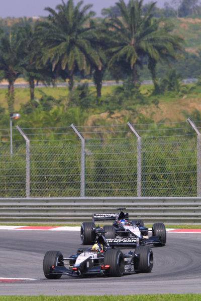 2001 Malaysian Grand Prix.Sepang, Kuala Lumpur, Malaysia. 16-18 March 2001.Tarso Marques followed by team mate Fernando Alonso (both Minardi PS01 European's).World Copyright - LAT Photographicref: 8 9MB DIGITAL IMAGE