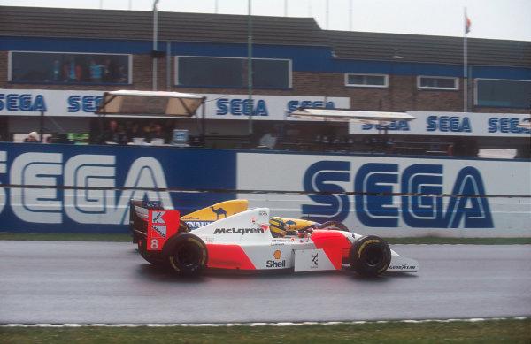 1993 European Grand Prix. Donington Park, England. 9-11 April 1993. Ayrton Senna (McLaren MP4/8 Ford) passes Damon Hill (Williams FW15C Renault). Ref-93 EUR 30. World Copyright - LAT Photographic