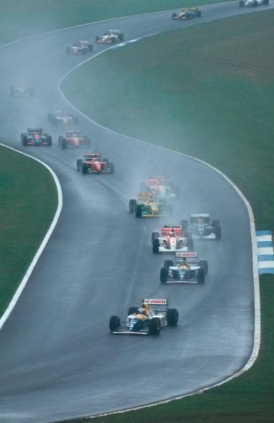 1993 European Grand Prix. Donington Park, England. 9-11 April 1993. Alain Prost leads teammate Damon Hill (both Williams FW15C Renault's), Ayrton Senna (McLaren MP4/8 Ford), Karl Wendlinger (Sauber C12 Ilmor), Michael Schumacher (Benetton B193B Ford), Michael Andretti (McLaren MP4/8 Ford) and Jean Alesi (Ferrari F93A) through Craner Curves to the Old Hairpin at the start.  Ref-93 EUR 02. World Copyright - LAT Photographic