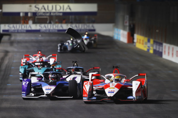 Alexander Sims (GBR) Mahindra Racing, M7Electro, battles with Jake Dennis (GBR) BMW I Andretti Motorsport, BMW iFE.21, as body work flies through the air