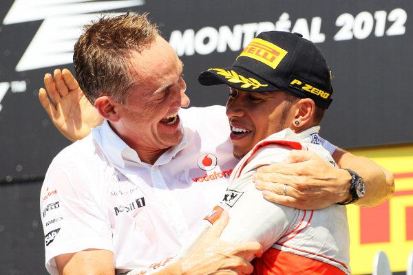 Martin Whitmarsh (GBR) McLaren Chief Executive Officer and Lewis Hamilton (GBR) McLaren celebrates on the podium.Formula One World Championship, Rd7, Canadian Grand Prix, Race, Montreal, Canada, Sunday 10 June 2012.