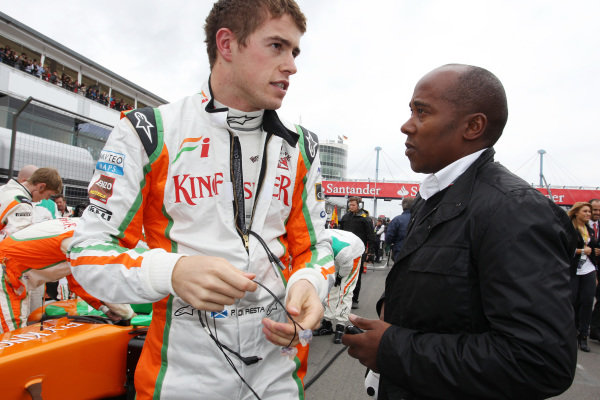 Paul di Resta (GBR) Force India with Anthony Hamilton (GBR).  Formula One World Championship, Rd 10, German Grand Prix, Race, Nurburgring, Germany, Sunday 24 July 2011.