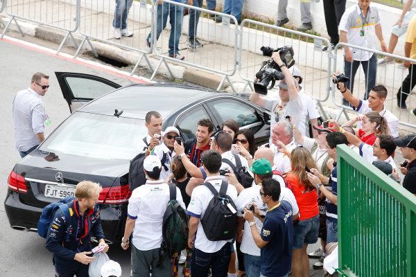 Interlagos, Sao Paulo, Brazil. Sunday 9 November 2014. Daniel Ricciardo, Red Bull Racing, poses for photos with fans. World Copyright: Charles Coates/LAT Photographic. ref: Digital Image _J5R5381
