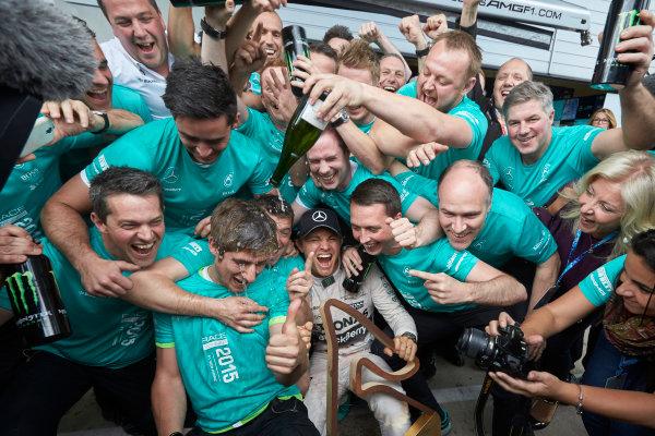Red Bull Ring, Spielberg, Austria. Sunday 21 June 2015. Nico Rosberg, Mercedes AMG, 1st Position, celebrates with his team. World Copyright: Steve Etherington/LAT Photographic. ref: Digital Image SNE25035