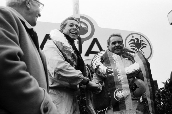 Olivier Gendebien and Phil Hill celebrate victory on the podium.
