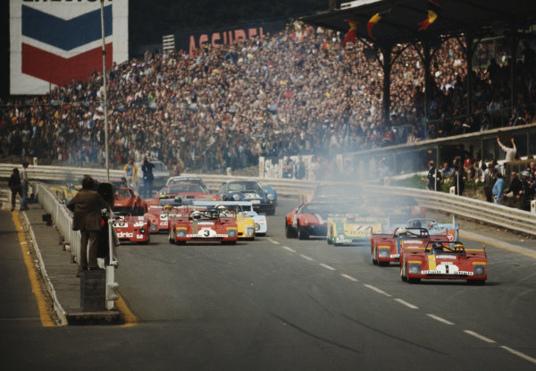 Jacky Ickx / Clay Regazzoni , Spa Ferrari SEFAC, Ferrari 312 PB 0888 leads the field at the start of the race.