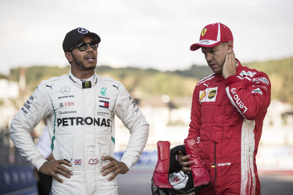 Lewis Hamilton, Mercedes AMG F1, and Sebastian Vettel, Ferrari, after qualifying.