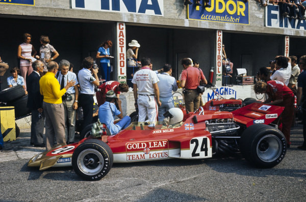 John Miles sits in his Lotus 72C Ford in the pits.