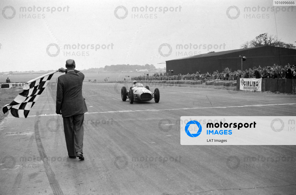 Reg Parnell, BRM P15 takes the chequered flag.