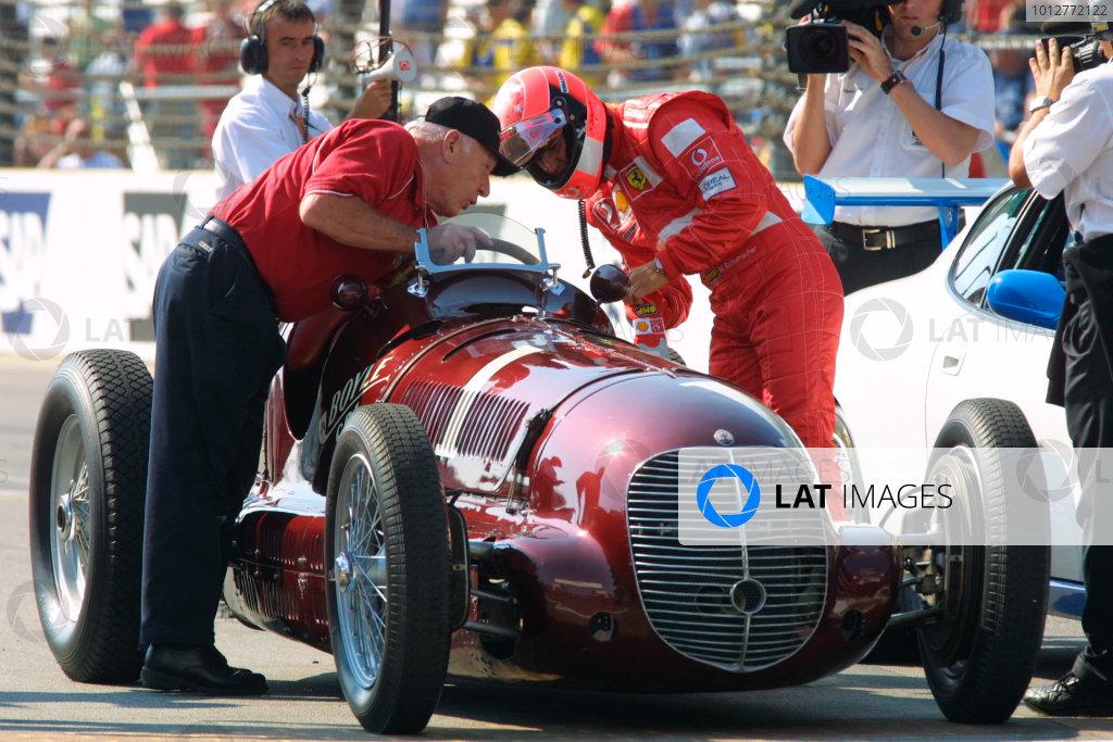 2002 American Grand Prix.Indianapolis, Indiana, USA. 27-29 September 2002.Michael Schumacher (Ferrari) drives the 1940 Indy 500 winning Maserati Tipo 8CTF