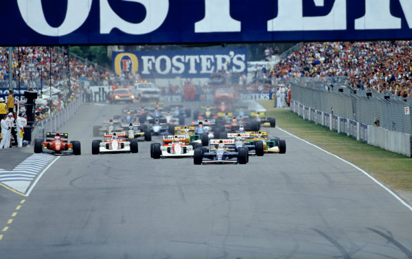 2003 Racing Past. . Exhibition1992 Australian Grand Prix, Adelaide. Nigel Mansell leads at the start while Jean Alesi takes a wide line.World Copyright - LAT PhotographicExhibition ref: a097