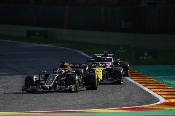 Romain Grosjean, Haas VF-19, leads Nico Hulkenberg, Renault R.S. 19, and Lance Stroll, Racing Point RP19