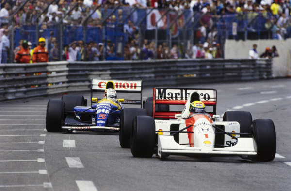 Ayrton Senna, McLaren MP4-7A Honda, leads Nigel Mansell, Williams FW14B Renault.