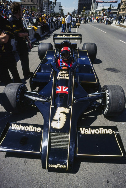 Mario Andretti sits in his Lotus 78 Ford.