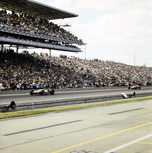 Jackie Stewart, John Mecom, Lola T90 Ford, leads Jim Clark, Lotus 38 Ford.