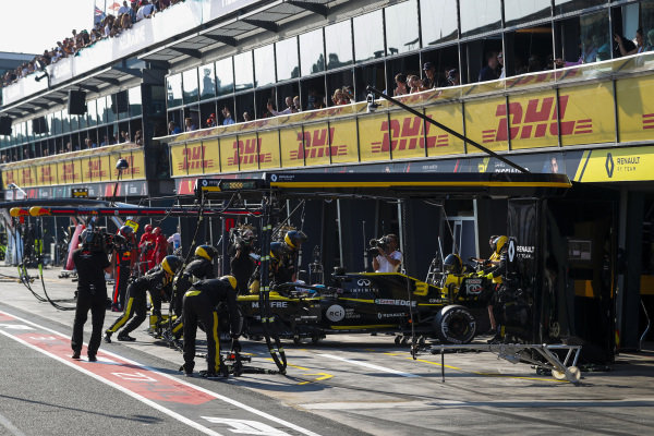 Daniel Ricciardo, Renault R.S.19, is pushed into the garage as he retires from the race