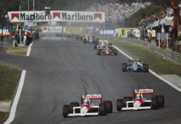 Alain Prost, McLaren MP4-4 Honda, leads team-mate Ayrton Senna.