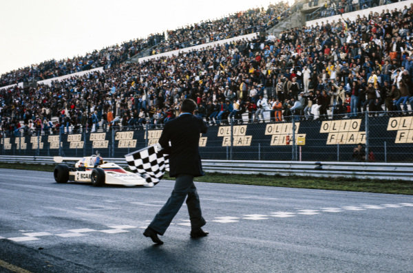 Vittorio Brambilla, March 752 BMW/Schnitzer, celebrates as he crosses the finish line and takes the chequered flag.