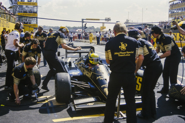 Ayrton Senna, Lotus 97T Renault, comes in for a pitstop.